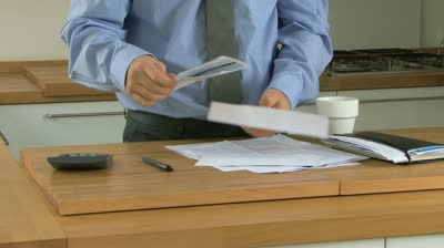stock-footage-wide-shot-pan-of-a-businessman-opening-a-letter