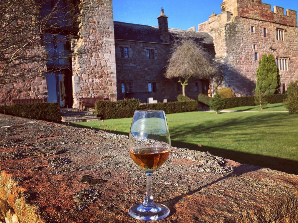 Islay whisky in front of a castle